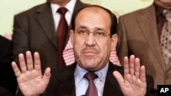 Thủ tướng Iraq Nouri al-Maliki nói chuyện với các nhà báo trong thủ đô Baghđ