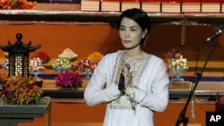 FILE - Chinese pop singer Faye Wong, also known as Wang Fei, performs at the third World Buddhist Forum in Hong Kong. China's state media have criticized celebrities for attending an event with members of the Tibetan government-in-exile.