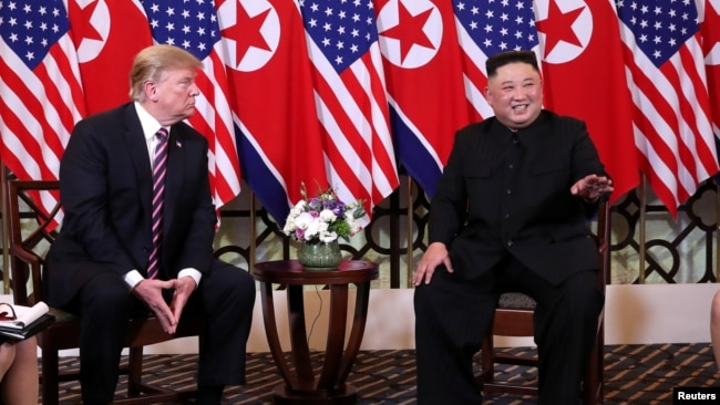 FILE - North Korean leader Kim Jong Un gestures as he and U.S. President Donald Trump sit down before their one-on-one chat during the second U.S.-North Korea summit at the Metropole Hotel in Hanoi, Vietnam, Feb. 27, 2019.