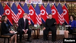 North Korean leader Kim Jong Un gestures as he and U.S. President Donald Trump sit down before their one-on-one chat during the second U.S.-North Korea summit at the Metropole Hotel in Hanoi, Vietnam, Feb. 27, 2019.