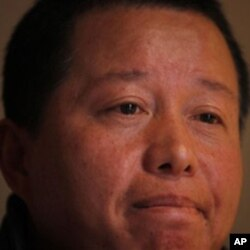 Gao Zhisheng ponders during his first meeting with the media since he briefly resurfaced in Beijing, April 7, 2010. His family has not heard from him since.