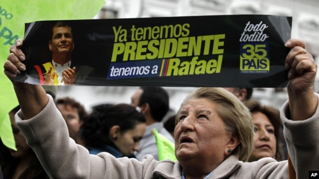 A supporter of Ecuador's President Rafael Correa celebrates his election victory in Quito, Ecuador, February 17, 2013.