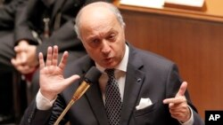 FILE - French Foreign Minister Laurent Fabius addresses members of parliament during questions to the government at the National Assembly in Paris, Oct. 9, 2013.
