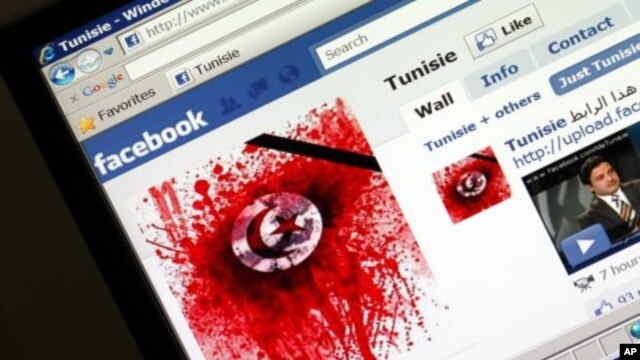 A student-run Facebook page shows an image depicting the Tunisian national flag smeared in red on a computer screen, 11 Jan 2011