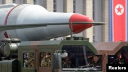 FILE - A North Korean military vehicle is seen carrying a missile during a parade in Pyongyang.