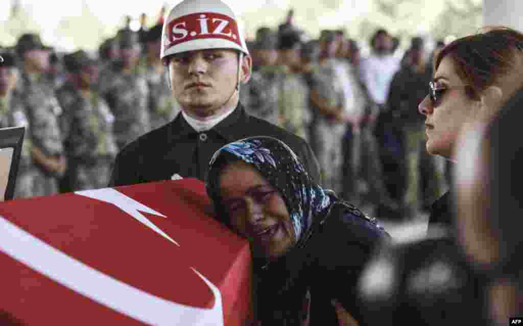 The mother of Turkish soldier Mehmet Yalcin Nane cries during a burial ceremony in Gaziantep. Turkish fighter jets bombed positions of Islamic State jihadists inside Syria for the first time on Friday. Operations came after first major cross-border clashes between Turkey and IS jihadists on Thursday left the Turkish soldier and one militant dead, thrusting Turkey into an open conflict with the Islamists.