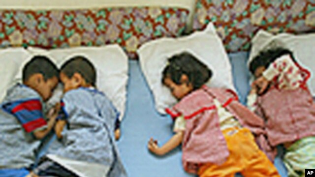 Abandoned children sleep in an orphanage in Morocco