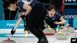 Japan's Chinami Yoshida shouts instructions to teammates during their women's curling match against China at the 2018 Winter Olympics in Gangneung, South Korea, Feb. 17, 2018.