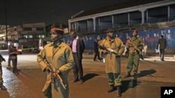 Policemen secure the scene of a deadly grenade explosion in Kenya's capital, Nairobi, October 24, 2011.