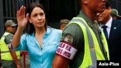 FILE - Venezuela's opposition leader Maria Corina Machado arrives at the state prosecutor's office in Caracas, Dec. 3, 2014.