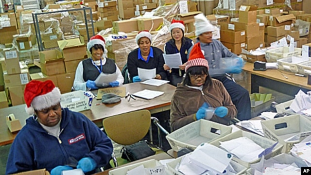 "Some of the 22 postal  ""elves"" who volunteer to organize letters to Santa and arrange for the public or charities to ""adopt"" them."