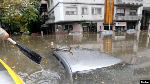 Submerged cars in a flooded street after a rainstorm in La Plata, Argentina, April 2, 2013.
