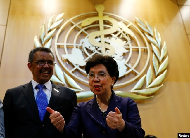 FILE - Outgoing Director-General Margaret Chan, right, poses with Tedros Adhanom Ghebreyesus after his election as Director General of the World Health Organization (WHO) during the 70th World Health Assembly in Geneva, Switzerland, May 23, 2017.