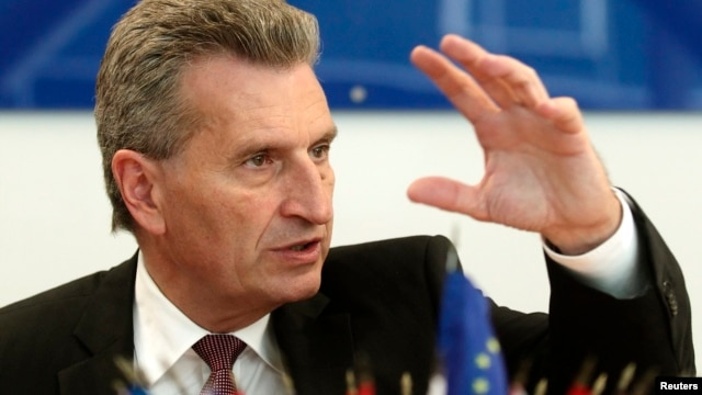European Energy Commissioner Guenther Oettinger addresses a news conference in Vienna, June 16, 2014.