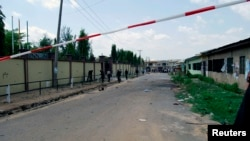 Security personnel seal the scene of a bomb attack in Kano, Nigeria, July 27, 2014.