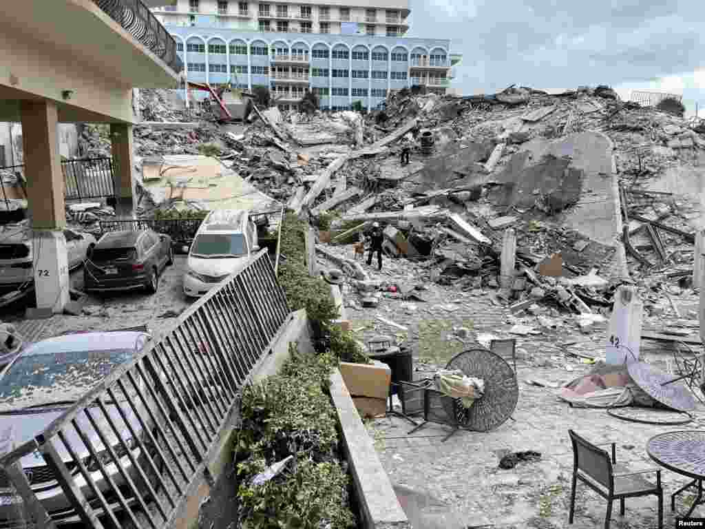 Emergency personnel work at the site of a partially collapsed building in Miami Beach, Florida.(Miami-Dade Fire Rescue/Handout)