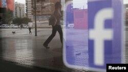 FILE - The Facebook logo is seen on a shop window in Malaga, Spain, June 4, 2018.