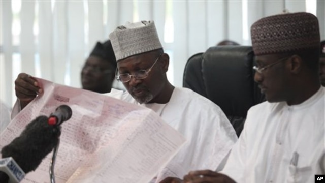 Attahiru Jega, Independent National Electoral Commission Chairman, reads the results sheet before he declared Nigeria's incumbent President Goodluck Jonathan as the winner of the presidential election, in Abuja, Nigeria, April 18, 2011