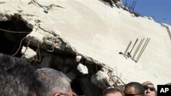 UN Secretary General Ban Ki-moon, centre, visits a destroyed house in Jebaliya, northern Gaza Strip, Sunday, March 21, 2010. U.N. chief Ban Ki-moon has entered the blockaded Gaza Strip, where 1.5 million people have been under lockdown by Israel and Egypt