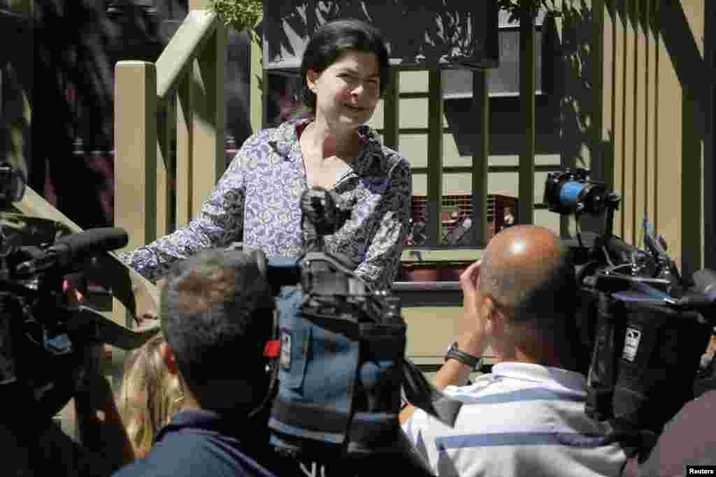 Viva Hardigg, cousin of American journalist Peter Theo Curtis, talks to reporters outside the house of Curtis' mother in Cambridge, Massachusetts, Aug. 25, 2014.