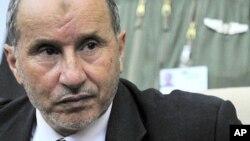 ທ່ານ Mustafa Abdel Jalil ຫົວໜ້າຝ່າຍກະບົດແລະເປັນປະທານ ສະພາປົກຄອງຊາດໄລຍະຂ້າມຜ່ານ ຂອງລີເບຍ. ວັນທີ 17 ສິງຫາ 2011