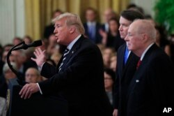 President Donald Trump, from left, with Justice Brett Kavanaugh and retired Justice Anthony Kennedy, speaks during the ceremonial swearing-in ceremony of Kavanaugh as Associate Justice of the Supreme Court of the United States in the East Room of the White House in Washington, Oct. 8, 2018.