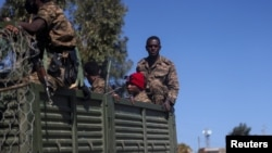 Ethiopian soldiers ride on a truck near the town of Adigrat, Tigray region, Ethiopia. (March 18, 2021)