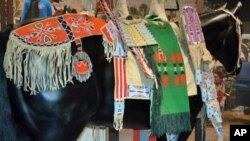 A model of how the Crow people dressed their horses in the 1880s is on display at the Museum of the American Indian. Note the beaded cradleboard for carrying an infant.