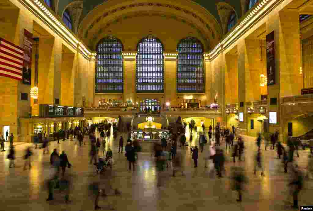 Travelers and commuters walk through Grand Central Station in New York, Nov. 27, 2013.