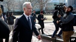 FILE - TobyMacFarlane departs federal court in Boston after facing charges in a nationwide college admissions bribery scandal, April 3, 2019.