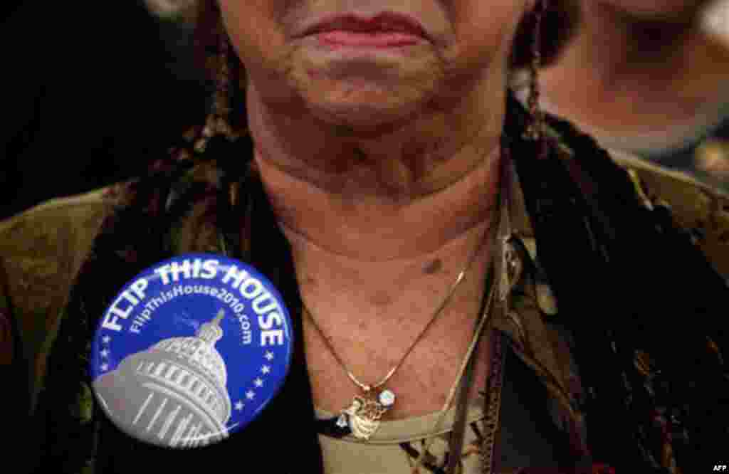 Paula Jost, of Palm Springs, Calif., wears a campaign button at a rally for Republicans in Anaheim, Calif., Saturday, Oct. 16, 2010. (AP Photo/Jae C. Hong)