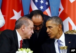 FILE - Turkish President Recep Tayyip Erdogan, left, and U.S. President Barack Obama chat during a session of the G-20 Summit in Antalya, Turkey, Nov. 15, 2015.