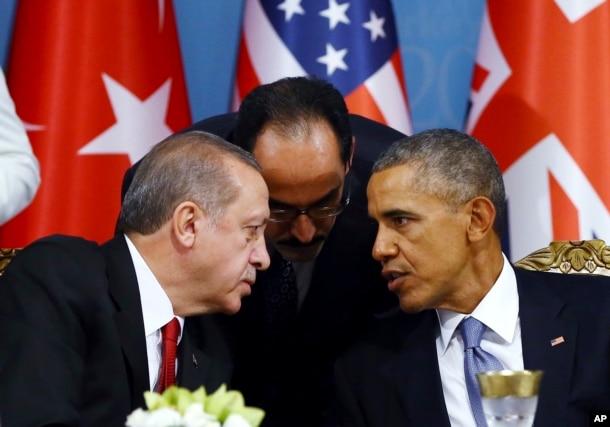 FILE - Turkish President Recep Tayyip Erdogan, left, and U.S. President Barack Obama chat during a session of the G-20 Summit in Antalya, Turkey, Nov. 15, 2015.