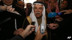 Saudi Arabia's Minister of Petroleum and Mineral Resources Ali Ibrahim Naimi speaks to journalists at a hotel in Vienna, Austria, Tuesday, Dec. 1, 2015. Saudi Arabia is OPEC's biggest oil producer.