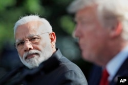 FILE - Indian Prime Minister Narendra Modi looks toward President Donald Trump as he speaks in the Rose Garden at the White House, June 26, 2017, in Washington.