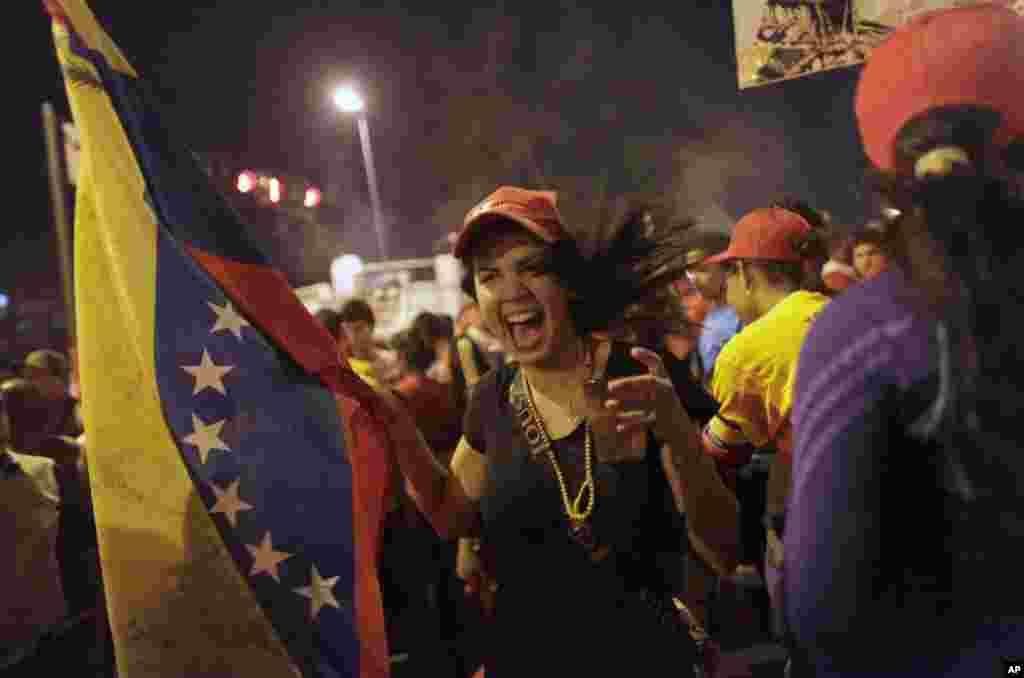 Government supporters celebrate after the official results of the presidential elections were announced at the Miraflores Palace in Caracas, Venezuela early Monday.