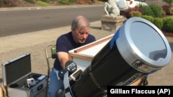 Amateur astronomer Mike Conley, of Salem, Oregon, is part of a project led by the National Solar Observatory to have citizen-scientists across the U.S. photograph the event in an effort to create a live movie of its path.