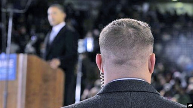 A Secret Service agent stands near then-presidential candidate Barack Obama [background] at a rally in Norfolk, Virginia, October 2008 (file photo)