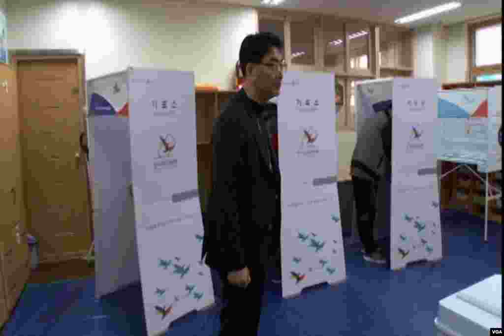 A voting official watches over polling for South Korea's election Tuesday.