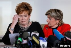 FILE - Beverly Young Nelson, left, reacts as she reads a statement to reporters with attorney Gloria Allred during a news conference announcing new allegations of sexual misconduct against Alabama Republican congressional candidate Roy Moore, in New York, Nov. 13, 2017.