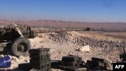 Canon aims at rebel positions in strategic rebel-held Yabroud area, near Damascus, Feb. 15, 2014.