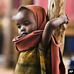 A newly arrived Somali refugee child awaits medical examinations at the Dadaab camp, near the Kenya-Somalia border
