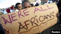 FILE: Migrants in Cape Town's Mannenberg community demonstrate against xenophobia. (UTERS/Mike Hutchings)
