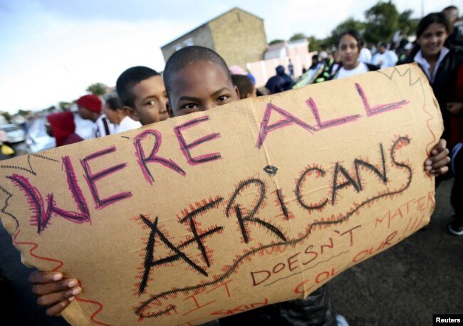 FILE - Migrants in Cape Town's Mannenberg community demonstrate against xenophobia. (UTERS/Mike Hutchings)