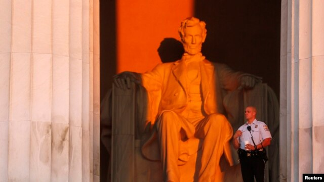 FILE - U.S. Park Police watch over the Lincoln Memorial, Aug. 24, 2013.