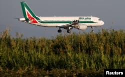 FILE - An Alitalia airplane approaches to land at Fiumicino airport in Rome, Italy, Oct. 24, 2018.