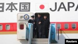 2018年2月9日,日本首相安倍晉三抵達南韓訪問(路透社)
