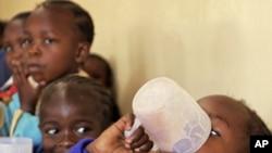 School children drink porridge at the Raila Education Center, a part of a school feeding program in Kibera slum, Nairobi (file photo)