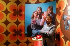 "Former ABBA member Bjorn Ulvaeus poses for the media in front of an exhibit at the new ""ABBA - The Museum"" in Stockholm, May 6, 2013. Picture on wall shows former ABBA members (L-R) Anni-Frid Lyngstad, Bjorn Ulvaeus, Agnetha Faltskog and Benny Andersson."