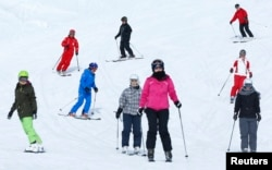 Skiers and snowboarders share the slopes.